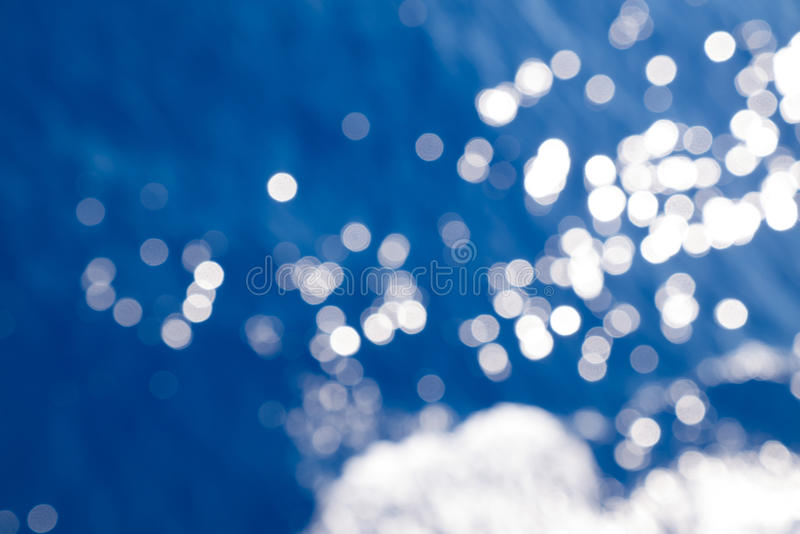 Water bokeh in the sea. Bokeh effect on a seawater surface with waves royalty free stock image