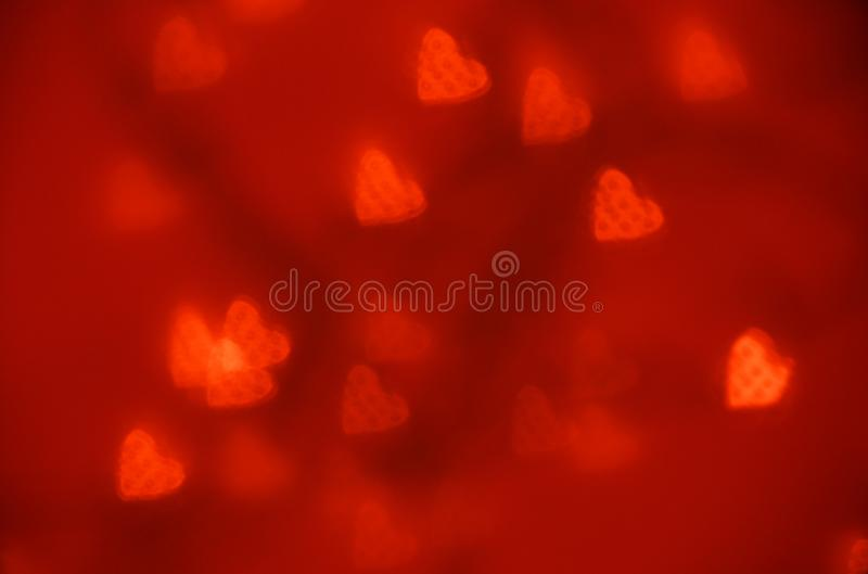 Bokeh för hjärta för Glittar texturwitn röd Valentinas dagbakgrund arkivfoto