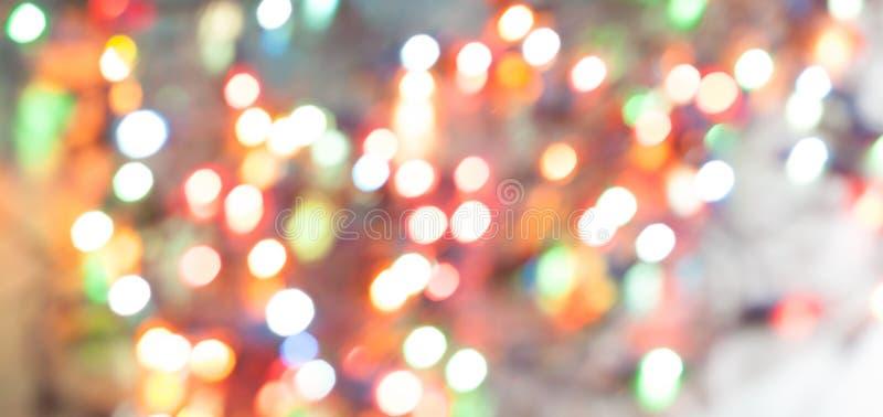 Bokeh för julljus som är suddig ut ur fokusbakgrund horizont royaltyfri foto