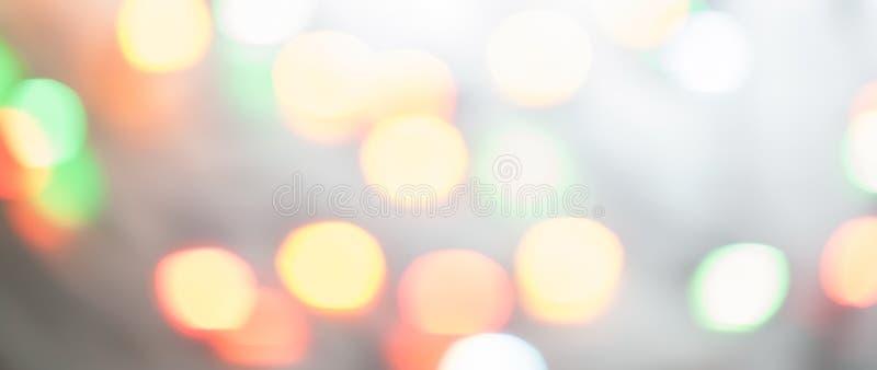 Bokeh för julljus som är suddig ut ur fokusbakgrund horizont royaltyfri fotografi