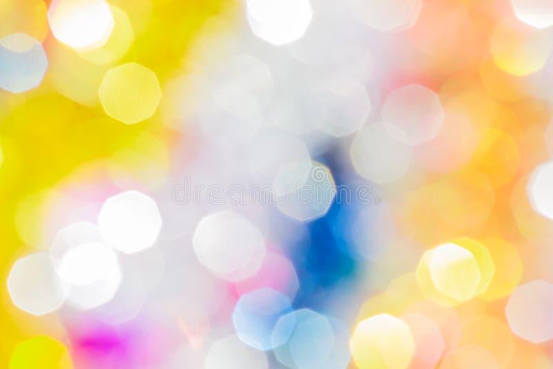 Bokeh festivo giallo, blu, arancio e bianco di Natale immagine stock libera da diritti