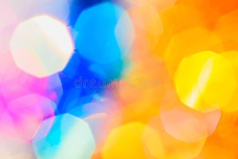 Bokeh festivo porpora, blu e giallo di Natale immagini stock