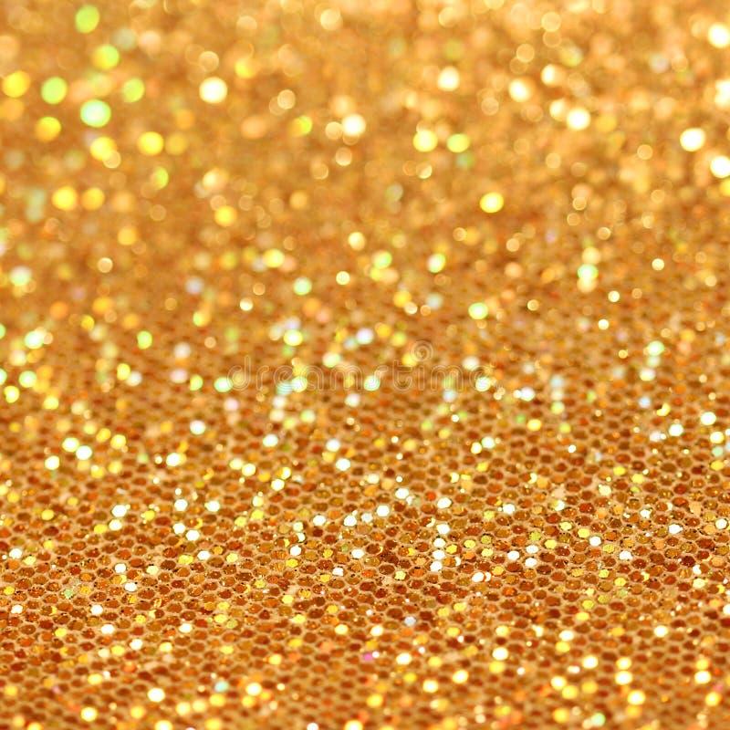 Bokeh. Fondo del centelleo del oro de la Navidad fotos de archivo
