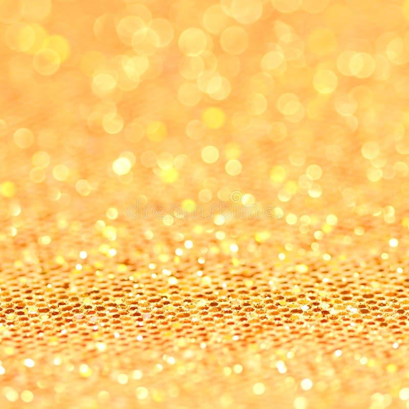 Bokeh. Fondo del centelleo del oro de la Navidad imagenes de archivo
