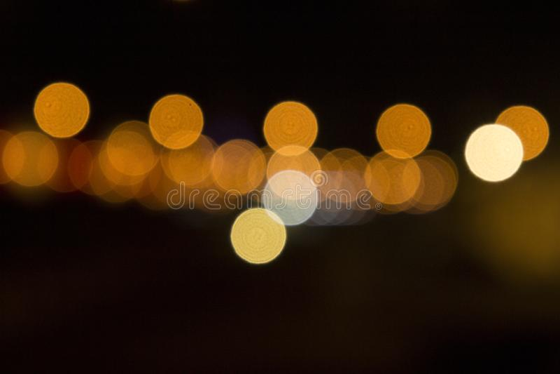 Bokeh giallo sulla via fotografie stock libere da diritti