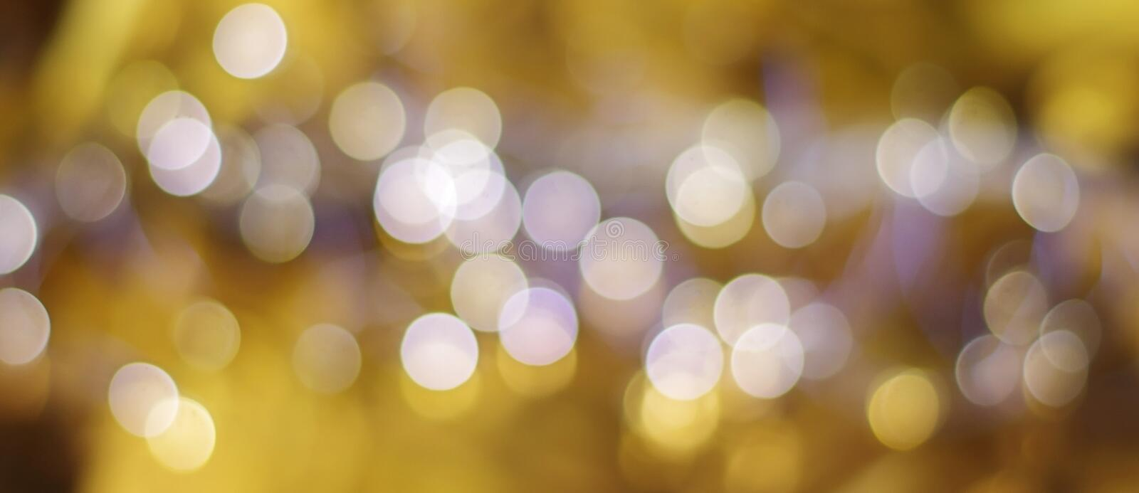 Bokeh gold colour abstract background. Long banner format.  royalty free stock image