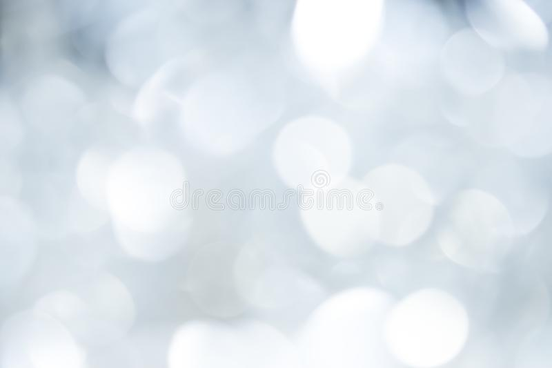 Bokeh grijze achtergrond van mooie lichten Conceptenkerstmis stock foto