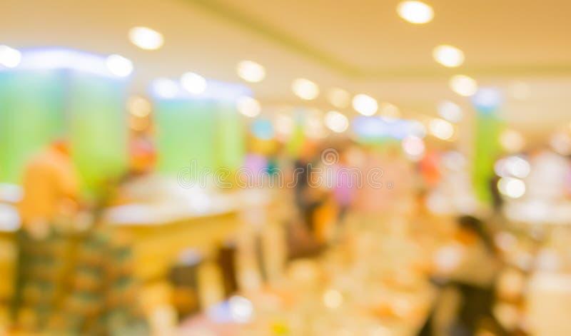 Bokeh of Interior of modern restaurant. Blurred shot Interior of modern restaurant stock photos