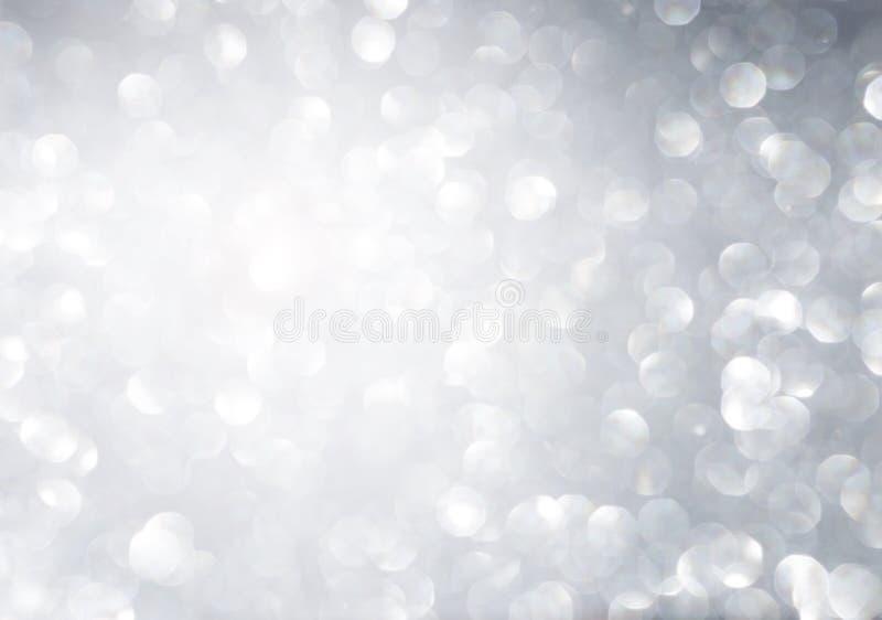 Bokeh leggero brillante astratto sopra fondo grigio fotografia stock libera da diritti