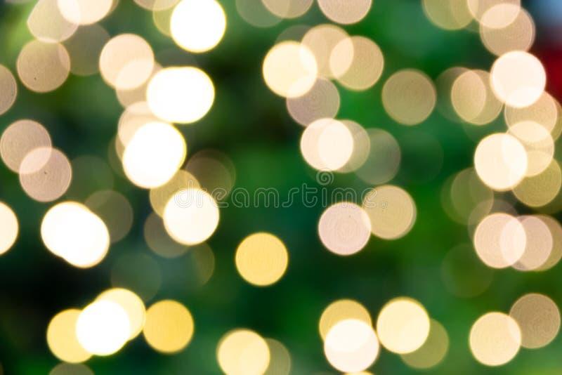 Bokeh leggero Defocused dell'albero della luce di natale, buon anno e fotografia stock libera da diritti