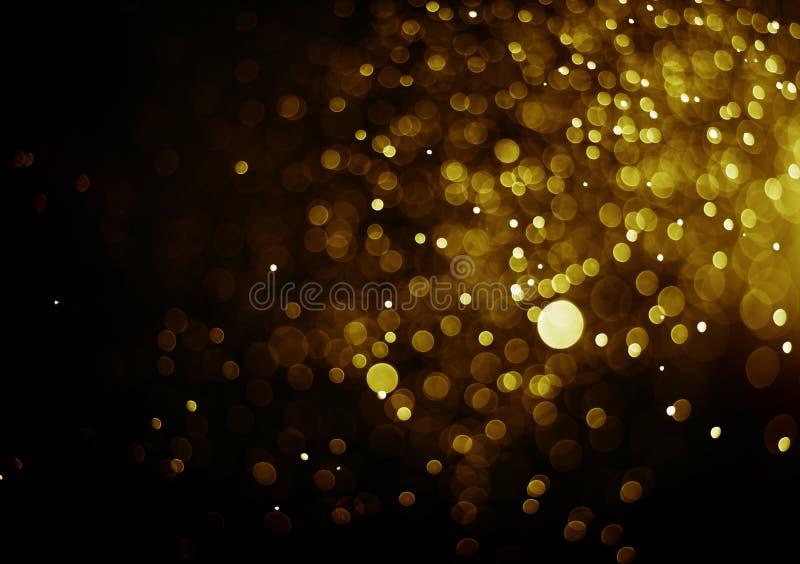 Bokeh-Lichtgoldfarbschwarzhintergrund stockfotografie
