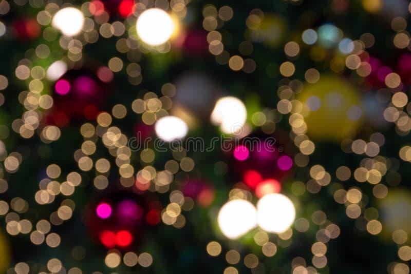Bokeh ligero Defocused del árbol de la luz de la Navidad, de la Feliz Año Nuevo y imagen de archivo