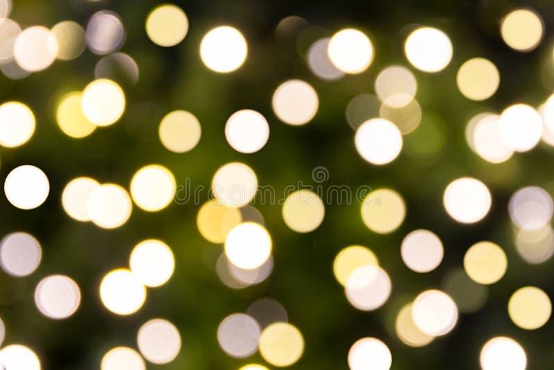 Bokeh ligero Defocused del árbol de la luz de la Navidad, de la Feliz Año Nuevo y foto de archivo libre de regalías