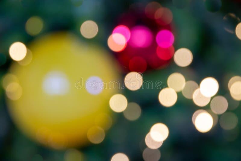 Bokeh ligero Defocused del árbol de la luz de la Navidad, de la Feliz Año Nuevo y fotografía de archivo libre de regalías