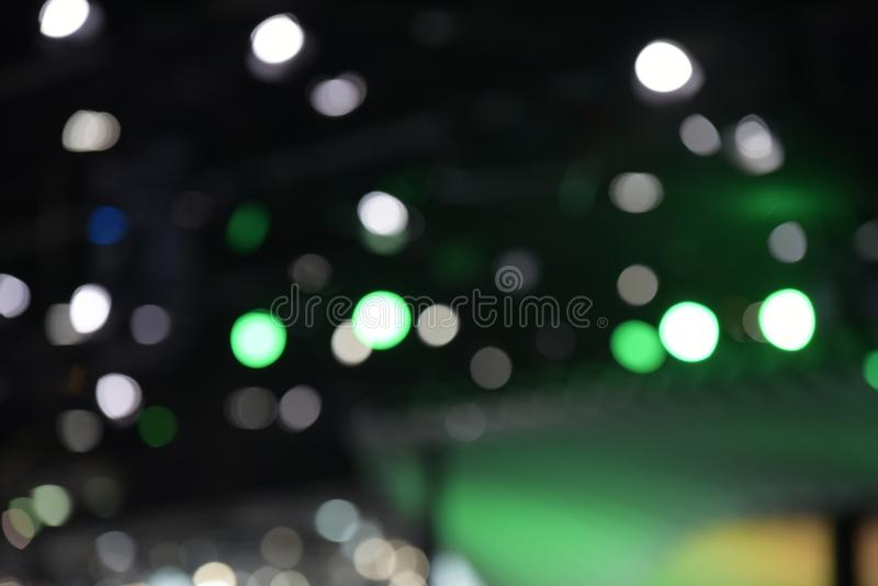 Bokeh of light in the car showroom at the motor show. Blurred images and beautiful bokeh of light in the car showroom at the motor show royalty free stock photo
