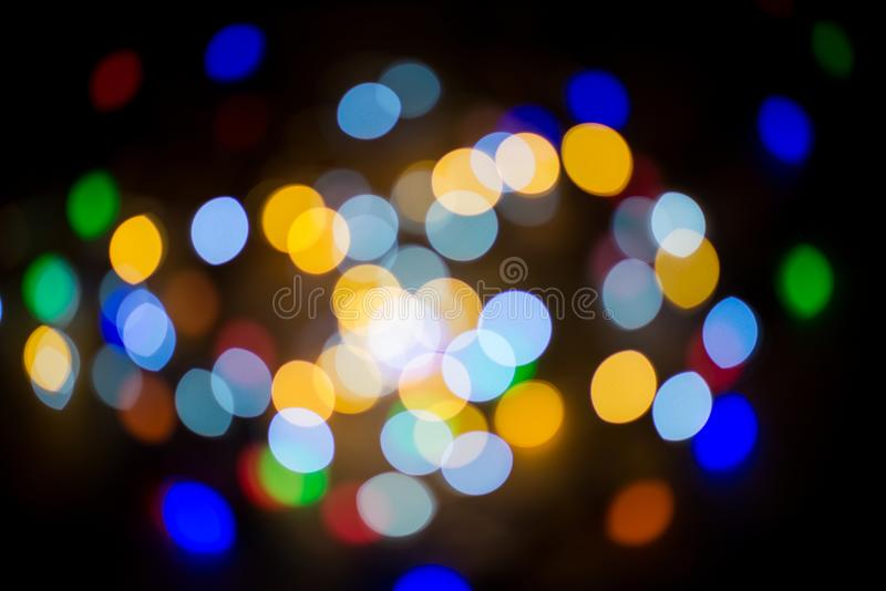 Bokeh lights. Against the background of blurred lanterns at night royalty free stock photography