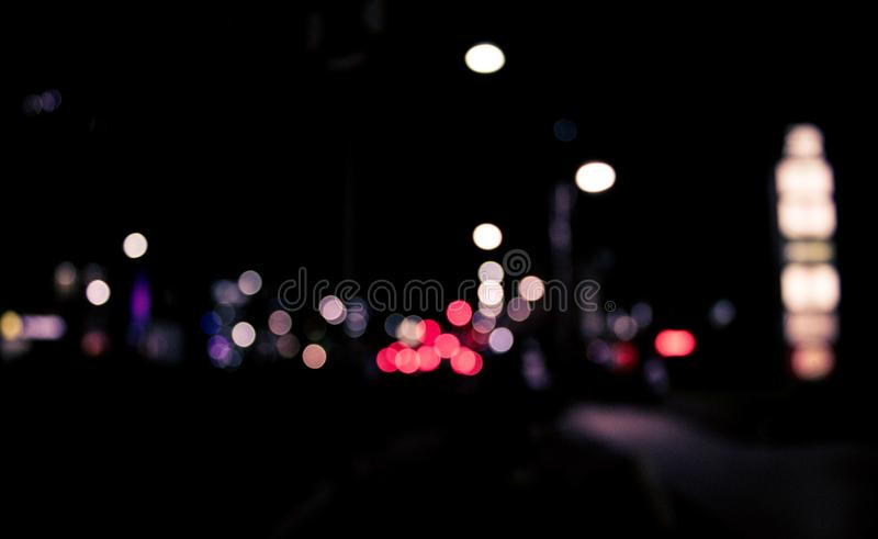 Bokeh lights in city street at night. stock photos