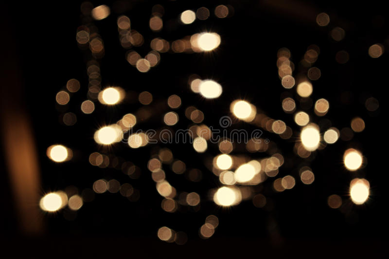 Bokeh lights. Abstract background of bokeh lights shining in the dark stock photo
