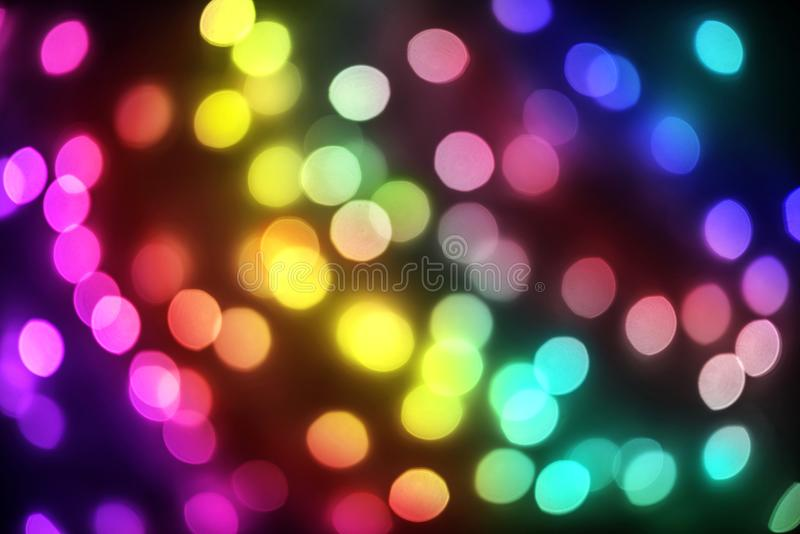 Bokeh lights holiday background. Defocused gold, blue, red and g stock image