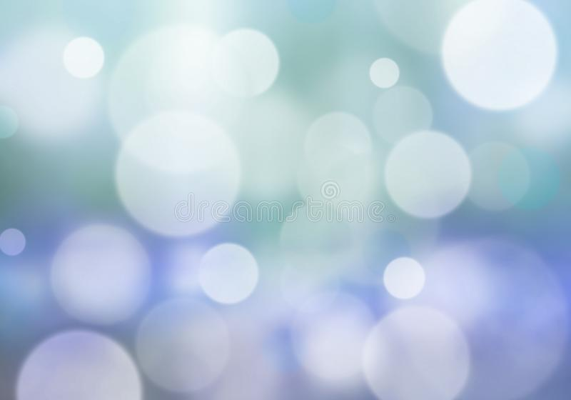 Bokeh lights in light blue and yellow - blur background stock photo