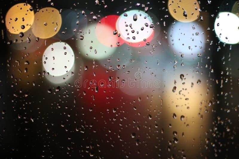 Bokeh lights through rainy window stock photography