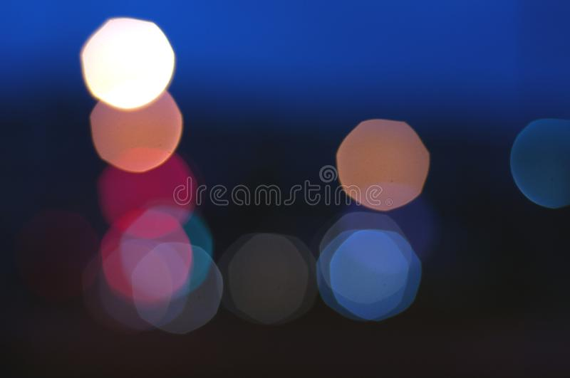 Bokeh lights on road in the city, night lights in city, street lights bokeh background, blur of night lights bokeh on street, stock photos