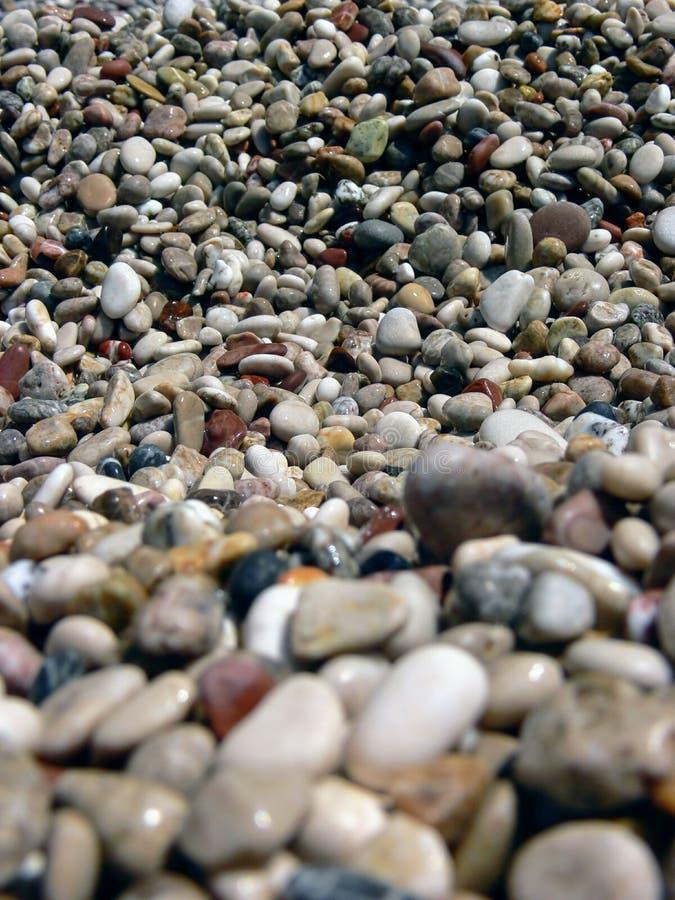 Bokeh macro natural de la playa del mar del guijarro foto de archivo