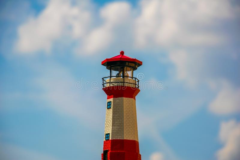 Bokeh of a minature lighthouse. Bokeh of a minature lighthouse against the blue sky royalty free stock photos