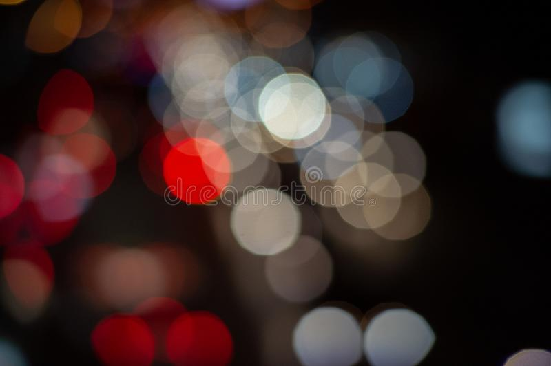 Bokeh night light on the avenue Light night at city blue bokeh sky festival abstract background blur lens flare reflection. Beautiful circle street with dark royalty free stock photography