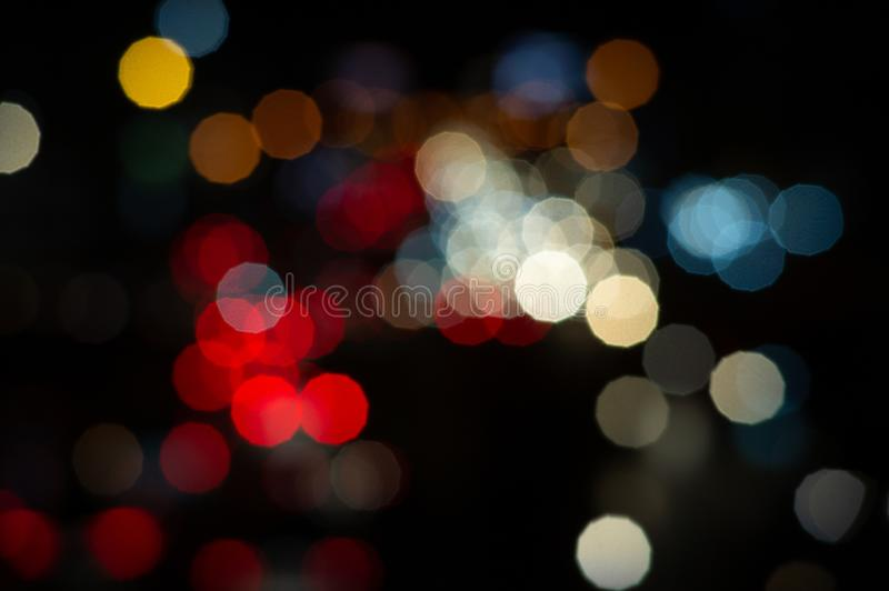 Bokeh night light on the avenue Light night at city blue bokeh sky festival abstract background blur lens flare reflection. Beautiful circle street with dark stock images