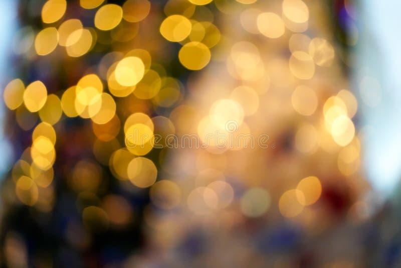Bokeh obscuro colorido & bonito do c?rculo, fora do fundo do foco no conceito e no tema do Natal fotografia de stock