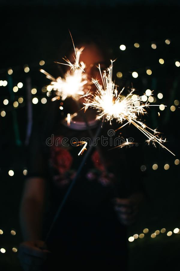 Bokeh Photography of Photo of Person Holding Sprinkler royalty free stock photo