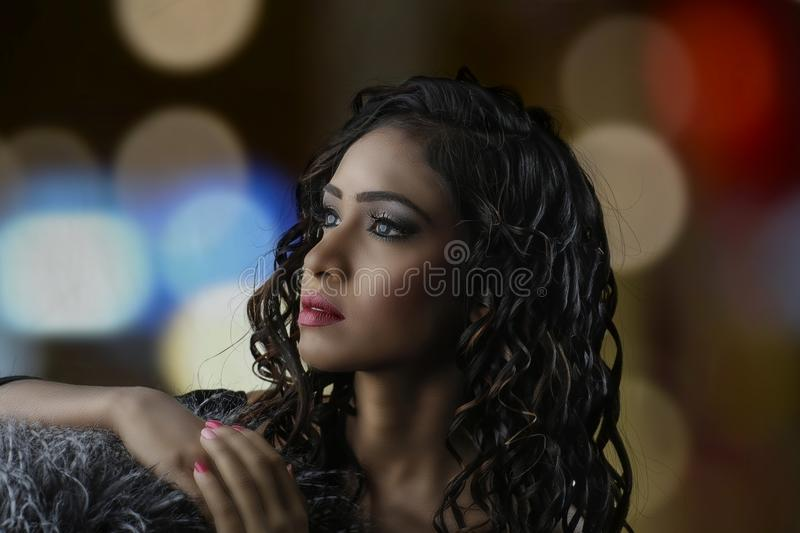 Bokeh Photography and Portrait of Curly-haired Woman royalty free stock image