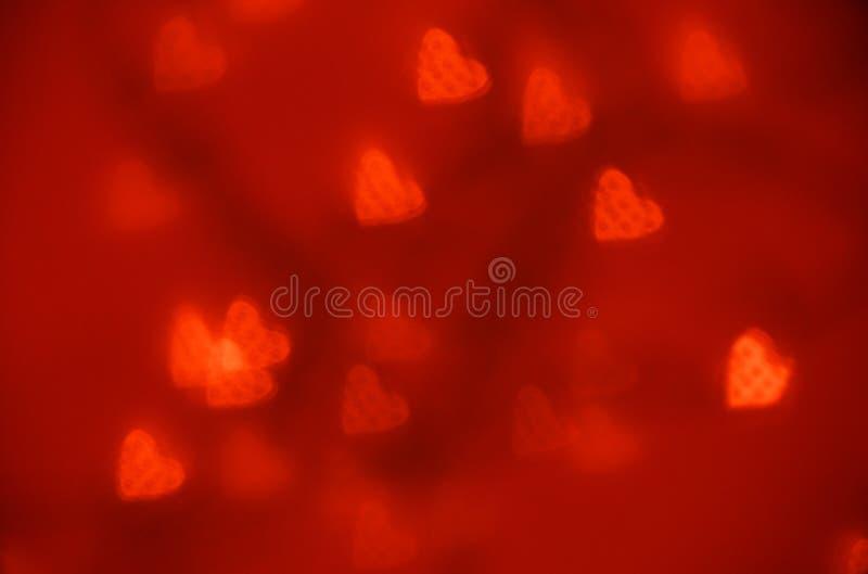 Bokeh rosso del cuore del witn di struttura di Glittar Fondo di giorno di Valentinas fotografia stock