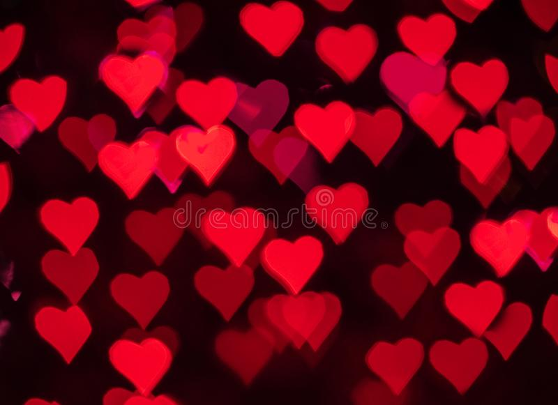 Bokeh rouge de coeurs comme fond pour Valentine' ; jour de s photo stock
