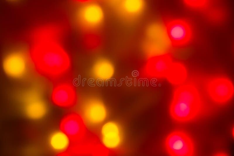Bokeh rouge et jaune de vacances Fond abstrait de Noël images libres de droits