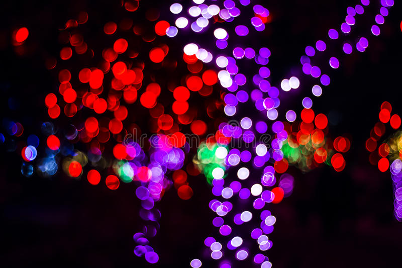 Bokeh of Seasonal Lights. In photography, bokeh is the aesthetic quality of the blur produced in the out-of-focus parts of an image produced by a lens. Bokeh has stock image