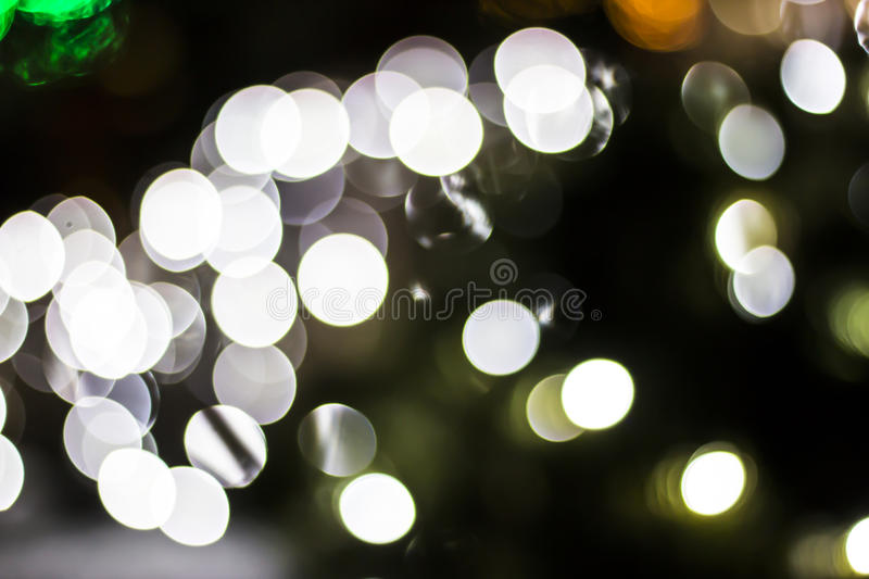 Bokeh of Seasonal Lights. In photography, bokeh is the aesthetic quality of the blur produced in the out-of-focus parts of an image produced by a lens. Bokeh has royalty free stock photography
