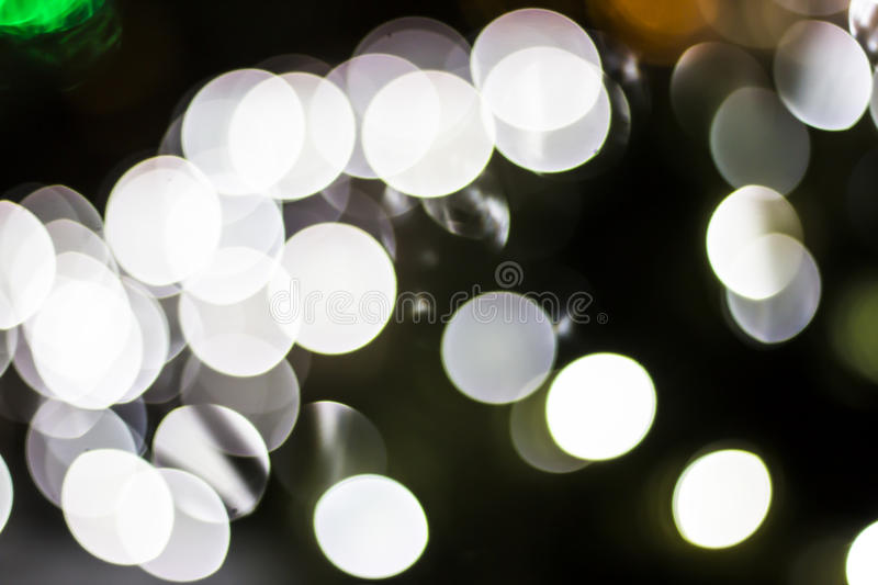 Bokeh of Seasonal Lights. In photography, bokeh is the aesthetic quality of the blur produced in the out-of-focus parts of an image produced by a lens. Bokeh has royalty free stock photos