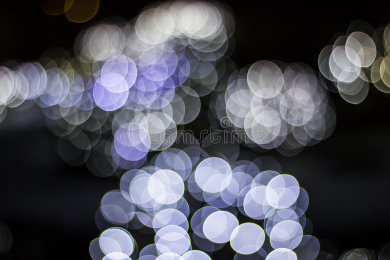 Bokeh of Seasonal Lights. In photography, bokeh is the aesthetic quality of the blur produced in the out-of-focus parts of an image produced by a lens. Bokeh has stock photography