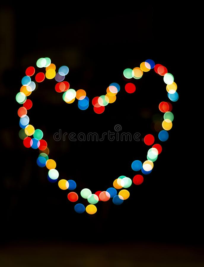 Bokeh with the shape of a heart with multi colors stock photos