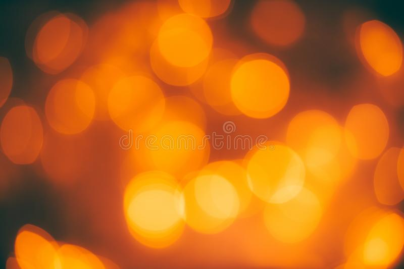 Bokeh shot of blurred orange lights with dark elements - perfect background royalty free stock images
