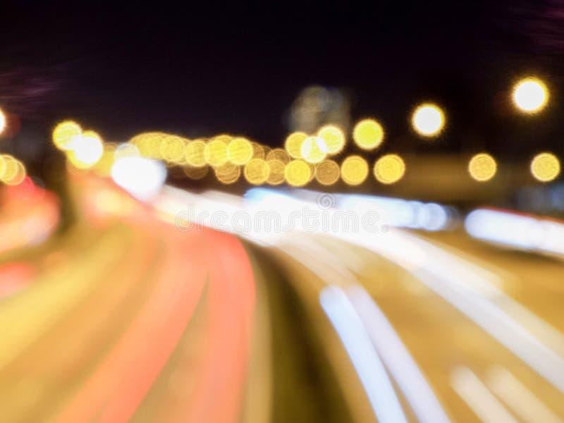 Bokeh si accende & la luce trascina fotografia stock