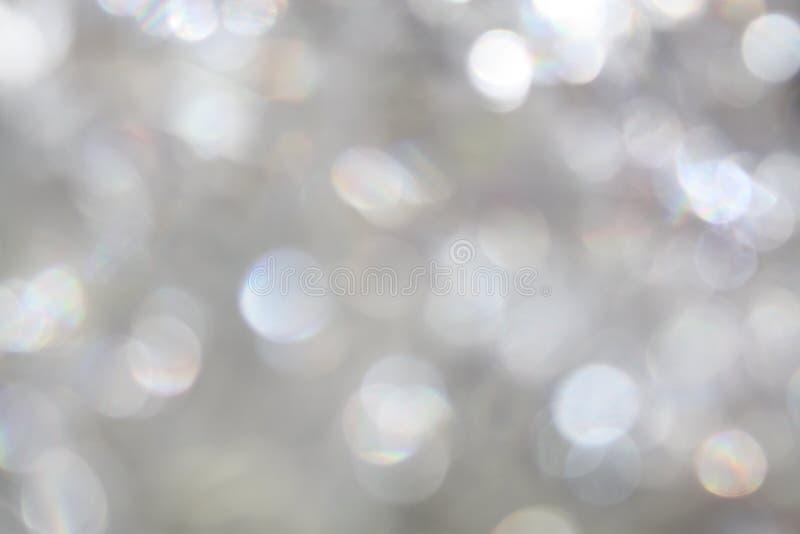 Bokeh silver white light universal shiny sparkle background. Texture royalty free stock photo