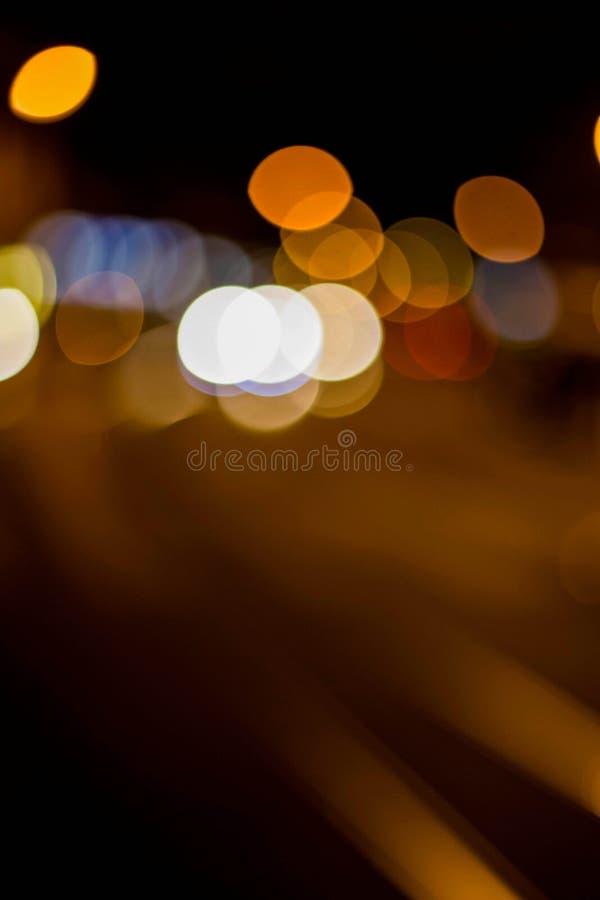 Bokeh tło z latarniami ulicznymi i poręczami zdjęcie royalty free