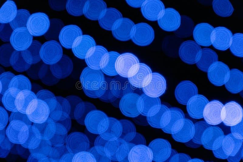 bokeh texturerar suddig bakgrund för suddig för ljusnatten för bakgrund blå baksida för staden arkivfoton