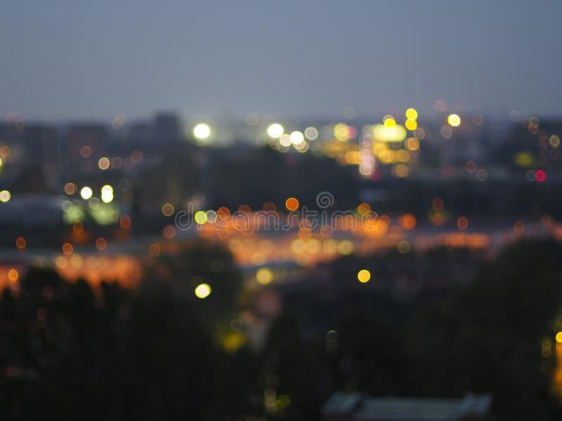 Bokeh in una città di notte fotografia stock libera da diritti