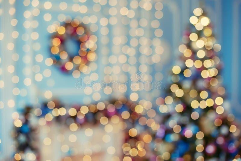 Bokeh vago della luce della ghirlanda Modello della sfuocatura di Natale, fondo defocused fotografie stock