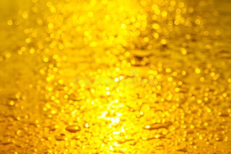 Bokeh van geel en gouden licht stock afbeeldingen