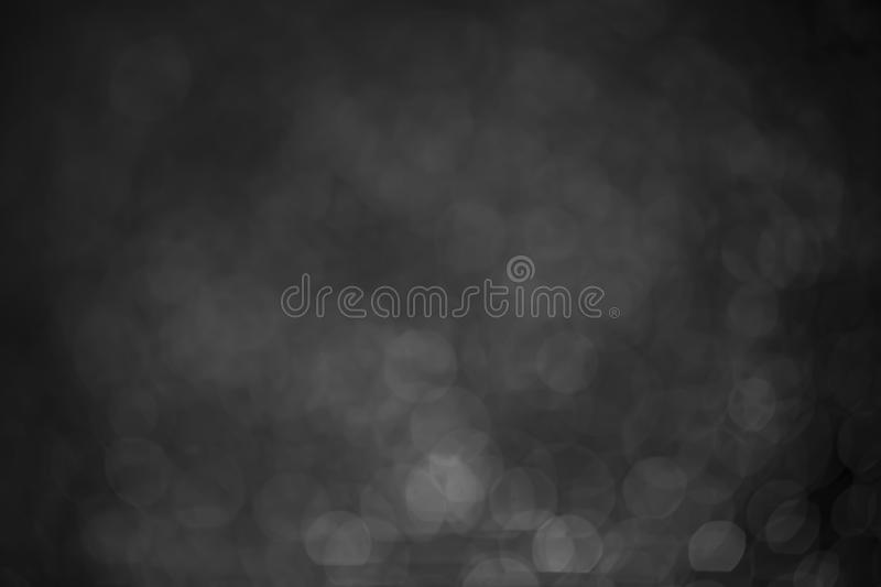 Bokeh water dot black and white for background. Abstract light dark flare design blue texture wallpaper holiday bright space macro celebration shiny reflection royalty free stock image